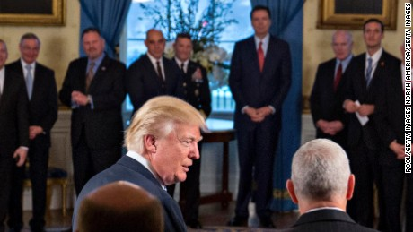 "WASHINGTON, DC - JANUARY 22: U.S. President Donald Trump (L) speaks next to U.S. Vice President Mike Pence during an Inaugural Law Enforcement Officers and First Responders Reception in the Blue Room of the White House on January 22, 2017 in Washington, DC. Trump today mocked protesters who gathered for large demonstrations across the U.S. and the world on Saturday to signal discontent with his leadership, but later offered a more conciliatory tone, saying he recognized such marches as a ""hallmark of our democracy."" (Photo by Andrew Harrer-Pool/Getty Images)"