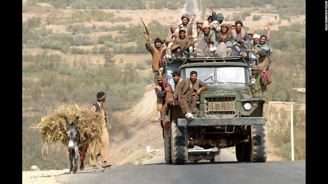 Soldiers with the Afghan Northern Alliance ride in a truck on October 19, 2001. They were opposition forces allied with the United States in its fight against the Taliban.