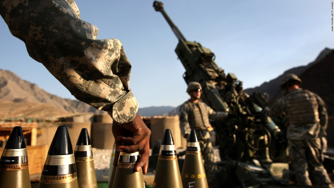 Troops wait to fire artillery on a Taliban position in Afghanistan's Kunar Province on October 22, 2008.