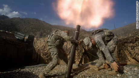 U.S. soldiers from the 2nd Battalion, 12th Infantry Regiment, 4th Brigade Combat Team, fire mortars at known enemy firing positions from a base in the Pech River Valley in Afghanistan's Kunar province, Saturday, Oct. 24, 2009. From left to right are SPC William Makenzie of Pendleton, OR and SPC Benjamin Pervis of Rochester, MN. (AP Photo/David Guttenfelder)