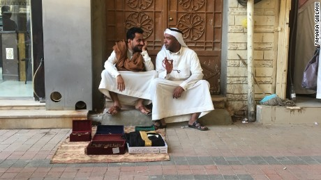 Two merchants sit with their goods in Riyadh's Al-Deera market.