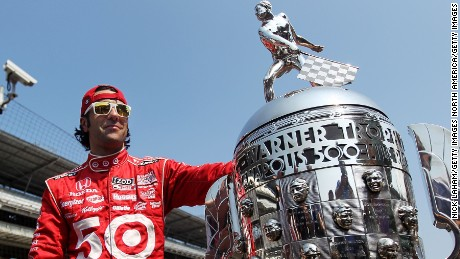 Dario Franchitti poses with the Borg Warner Trophy after his third Indy 500 victory in 2012.