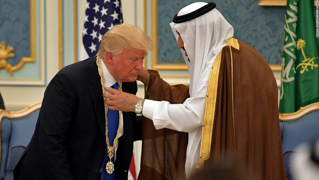 King Salman presents Trump with a gilded necklace and medal, the country's highest honor. The distinction also was bestowed upon Presidents Barack Obama and George W. Bush.