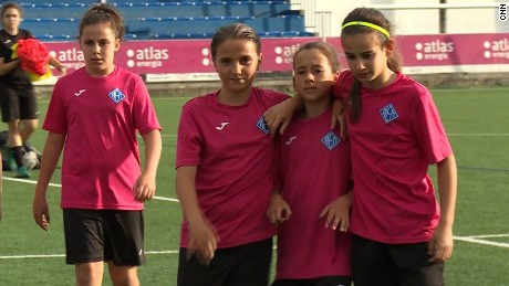 Players with AEM Lleida, a girls' soccer team that won in an all-boys' league, pause during practice.