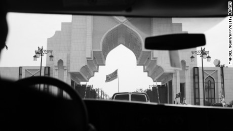 An entrance to the Saudi Royal Court is seen from inside of a press van as the motorcade of US President Donald Trump arrives in Riyadh on May 20, 2017. / AFP PHOTO / MANDEL NGAN        (Photo credit should read MANDEL NGAN/AFP/Getty Images)