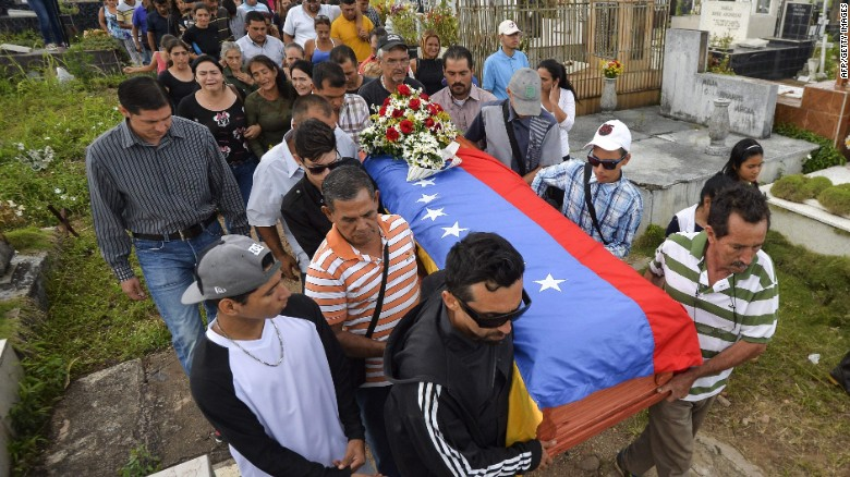 Relatives attend the funeral of Francisco Guerrero, a 15-year-old who died after he was injured May 17 during the political unrest in Venezuela's state of Tachira.