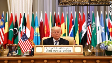 President Donald Trump waits to deliver a speech to the Arab Islamic American Summit, at the King Abdulaziz Conference Center, Sunday, May 21, 2017, in Riyadh, Saudi Arabia. (AP Photo/Evan Vucci)