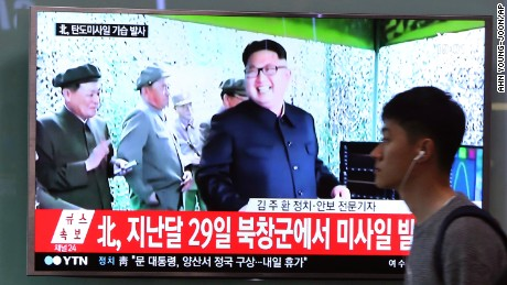 A man passes by a TV at the Seoul Railway Station showing file footage of North Korean leader Kim Jong Un, after North Korea fired a mid-range ballitic millile on Sunday, May 21.