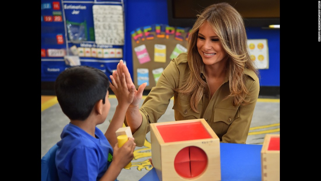 First lady Melania Trump high-fives a child during a visit to the American International School in Riyadh, Saudi Arabia, on May 21.