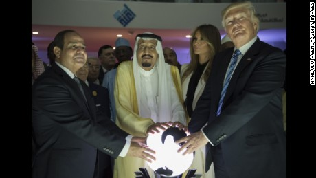 US President Donald Trump, US First lady Melania Trump (2nd R), Saudi Arabia's King Salman bin Abdulaziz al-Saud (2nd L) and Egyptian President Abdel Fattah el-Sisi (L) put their hands on an illuminated globe  during the inauguration ceremony of the Global Center for Combating Extremist Ideology in Riyadh, Saudi Arabia on May 21, 2017.