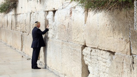 epa05981592 U.S. President Donald Trump touches the Western Wall, Judaism's holiest prayer site, in Jerusalem's Old City, 22 May 2017. Trump arrived for a 28-hour visit to Israel and the Palestinian Authority areas on his first foreign trip since taking office in January.  EPA/RONEN ZVULUN / POOL