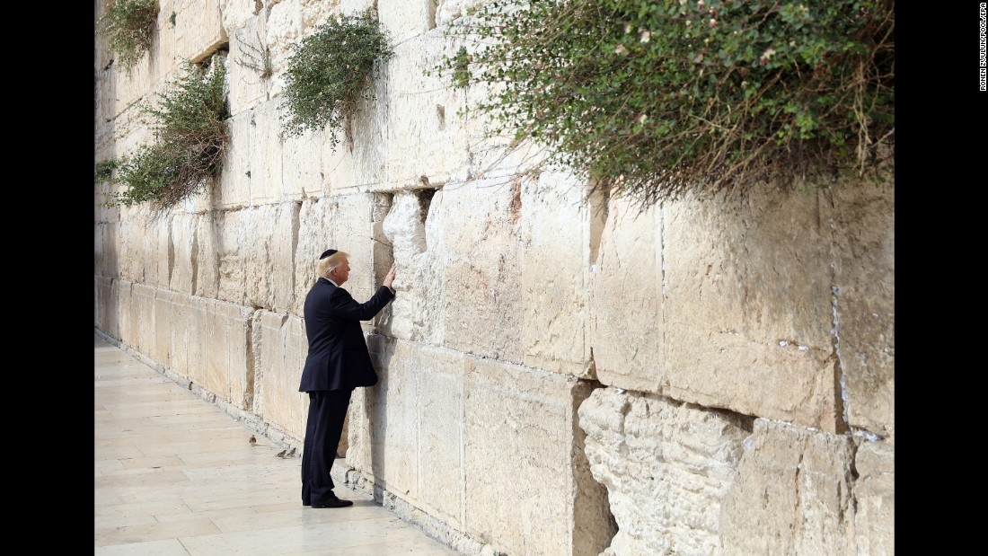 "Trump touches the Western Wall, Judaism's holiest prayer site, while in Jerusalem on May 22. Trump became <a href=""http://www.cnn.com/2017/05/22/politics/trump-israel-western-wall/"" target=""_blank"">the first sitting US president to visit the wall.</a>"