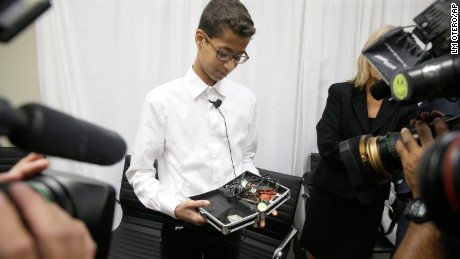 Ahmed Mohamed shows the clock he built after a 2016 news conference in Dallas.