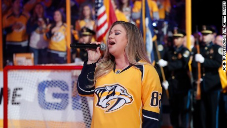NASHVILLE, TN - MAY 18: Artist Kelly Clarkson sings the National Anthem prior to Game Four of the Western Conference Final between the Nashville Predators and Anaheim Ducks during the 2017 NHL Stanley Cup Playoffs at Bridgestone Arena on May 18, 2017 in Nashville, Tennessee. (Photo by John Russell/NHLI via Getty Images)