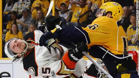 NASHVILLE, TN - MAY 18:  Pontus Aberg #46 of the Nashville Predators hits Sami Vatanen #45 of the Anaheim Ducks during the third period in Game Four of the Western Conference Final during the 2017 Stanley Cup Playoffs at Bridgestone Arena on May 18, 2017 in Nashville, Tennessee.  (Photo by Bruce Bennett/Getty Images)
