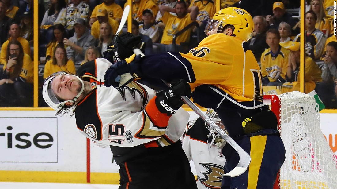 Nashville's Pontus Aberg hits Anaheim's Sami Vatanen during Game 4 of the NHL's Western Conference Final on Thursday, May 18.
