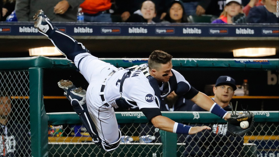 Detroit's James McCann dives for a foul ball during a Major League Baseball game against Texas on Saturday, May 20.