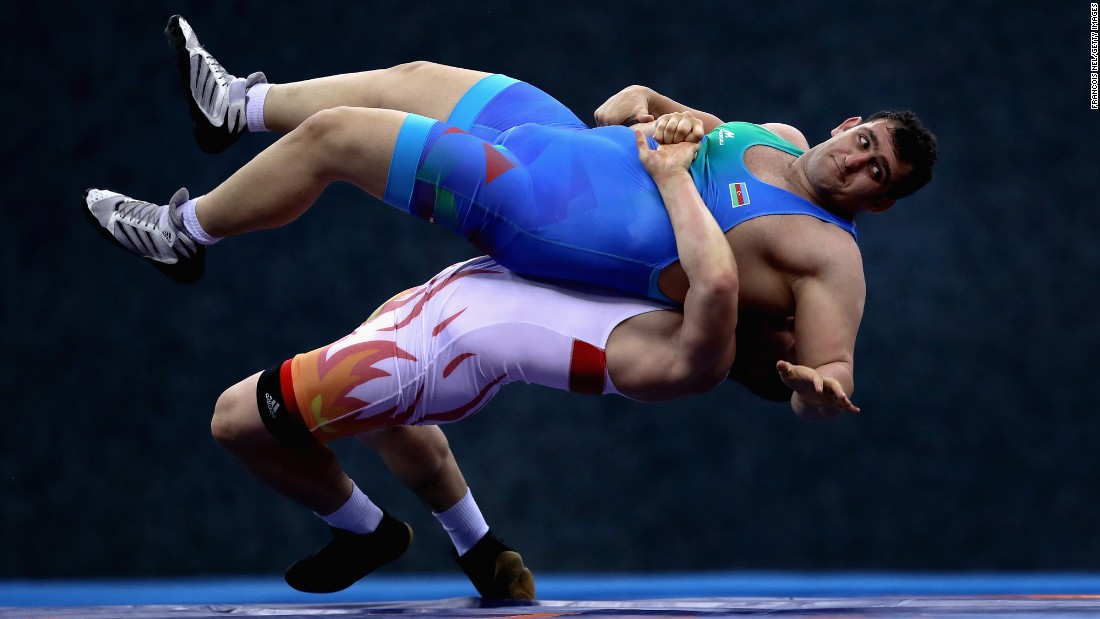 Azerbaijan's Sabah Shariati is thrown by Uzbekistan's Muminjon Abdullaev during a wrestling match at the Islamic Solidarity Games on Thursday, May 18.