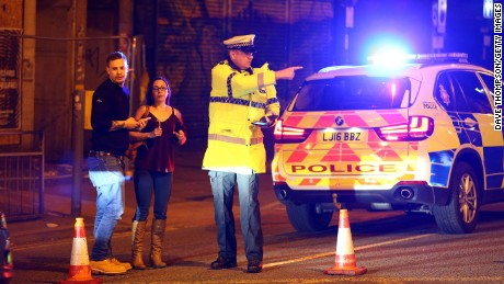 MANCHESTER, ENGLAND - Police stand by a cordoned off street close to the Manchester Arena on May 22, 2017 in Manchester, England.  There have been reports of explosions at Manchester Arena where Ariana Grande had performed this evening.  Greater Manchester Police have have confirmed there are fatalities and warned people to stay away from the area. (Photo by Dave Thompson/Getty Images)