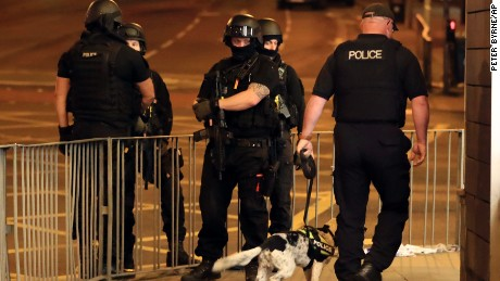Armed police work after an explosion at the Manchester Arena in Manchester, England Tuesday, May 23, 2017. An explosion struck an Ariana Grande concert attended by thousands of young music fans in northern England late Monday, killing over a dozen people and injuring dozens in what police said Tuesday was being treated as a terrorist attack. (Peter Byrne/PA via AP)