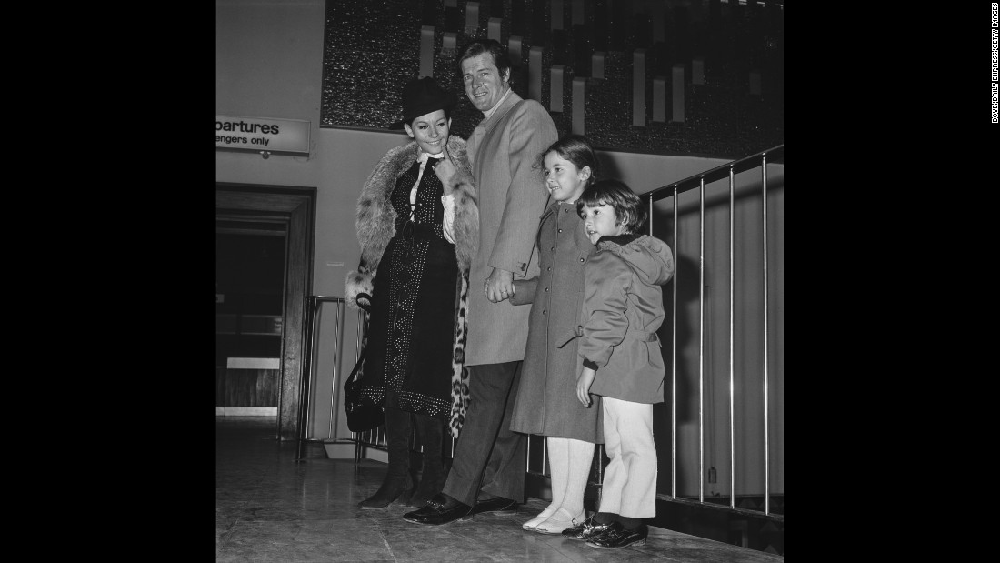 Moore and Mattioli are accompanied by their children at London Airport in 1971. Moore had three children, all with Mattioli.