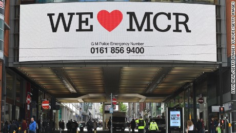 A sign saying 'We love Manchester' is displayed above a street on May 23, 2017 in Manchester, England.
