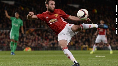 Manchester United's Spanish midfielder Juan Mata shoots but fails to score during the UEFA Europa League Round of 32 first-leg football match between Manchester United and Saint-Etienne at Old Trafford stadium in Manchester, north-west England, on February 16, 2017. / AFP / Oli SCARFF        (Photo credit should read OLI SCARFF/AFP/Getty Images)