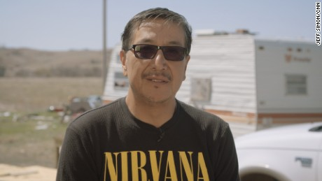 Chris Cuny outside of his home on the Pine Ridge Indian Reservation in South Dakota.