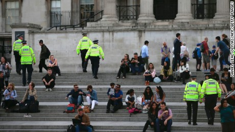 British police patrol through Trafalgar Square in central London on May 23, 2017 a day after a deadly terror attack at the Ariana Grande concert at the Manchester Arena.