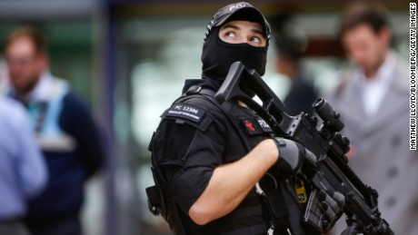 An armed police officer stands at Manchester Piccadilly railway station in Manchester, U.K., on Tuesday, May 23, 2017.