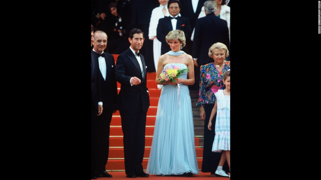 "Prince Charles and Princess Diana had been married for seven years by the time they took to the red carpet at Cannes. Wearing a blue chiffon dress by Catherine Walker, the princess delighted the press when she walked up the Palais steps on May 15. Years later, <a href=""http://www.telegraph.co.uk/news/1478421/Diana-I-thought-of-running-off-with-lover.html"" target=""_blank"">the Telegraph reported </a>an unsettling footnote to the event: According to tapes recorded in 1992 with her voice coach, Prince Charles told Diana of the death of her alleged lover Barry Mannakee, in a limousine on the way to the festival."