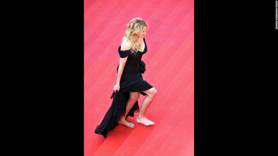 In 2016 festival organizers turned women away for not wearing heels on the red carpet. Julia Roberts' rebuttal? Walk the carpet barefoot.