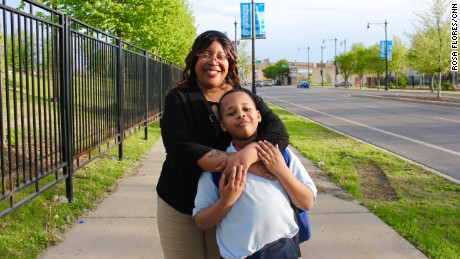 Rachel Norwood and her son, Justice Watkins, on their way home from his school.