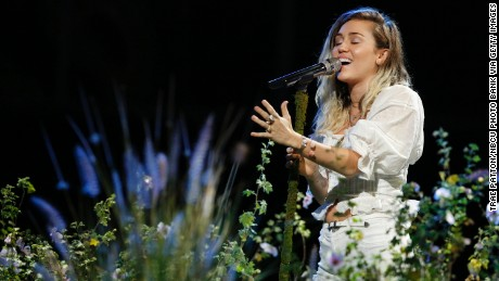 "Miley Cyrus performs ""Malibu"" on ""The Voice"" finale."