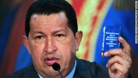 "Venezuela's President Hugo Chavez shows a Venezuelan Constitution as he delivers a speech during a press conference at the presidential palace of Miraflores in Caracas on July 29, 2009. Chavez decided Tuesday to ""freeze"" relations with neighboring Colombia and recall his envoy over accusations from Bogota that Caracas has links to Colombia's FARC Marxist guerillas. The move threatens to suspend billions of dollars in trade, and Chavez warned that Colombian-owned operations in Venezuela could be seized.   AFP PHOTO/THOMAS COEX (Photo credit should read THOMAS COEX/AFP/Getty Images)"