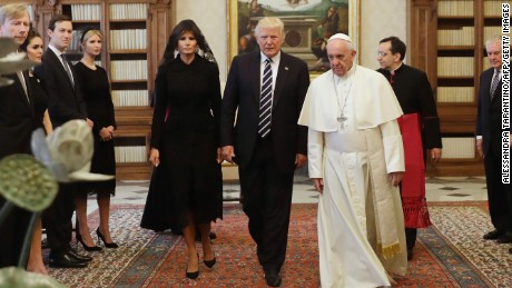 Pope Francis (R) walks along with US President Donald Trump (C) and US First Lady Melania Trump during a private audience at the Vatican on May 24, 2017. US President Donald Trump met Pope Francis at the Vatican today in a keenly-anticipated first face-to-face encounter between two world leaders who have clashed repeatedly on several issues. / AFP PHOTO / POOL / Alessandra Tarantino        (Photo credit should read ALESSANDRA TARANTINO/AFP/Getty Images)