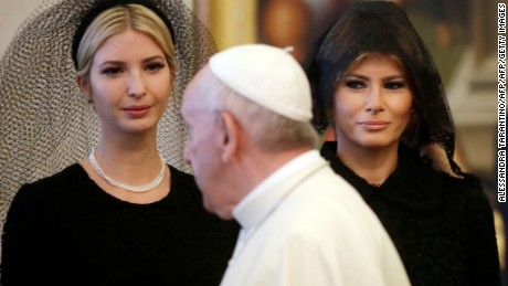 Pope Francis walks past US First Lady Melania Trump and the daughter of US President Donald Trump Ivanka Trump at the end of a private audience at the Vatican on May 24, 2017.