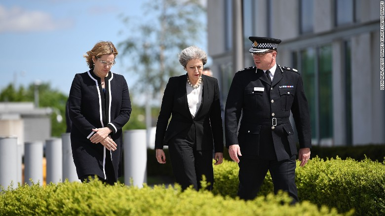 Home Secretary Amber Rudd and Britain's Prime Minister Theresa May (R) meet Chief Constable of Greater Manchester Police Ian Hopkins.
