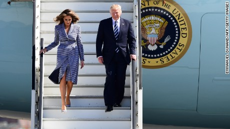 US President Donald Trump (R) and First Lady Melania Trump step off the Air Force One upon arrival at Brussels International Airport  on May 24, 2017. US President Donald Trump arrived in Brussels ahead of his first talks with NATO and European Union leaders.  / AFP PHOTO / Emmanuel DUNAND        (Photo credit should read EMMANUEL DUNAND/AFP/Getty Images)