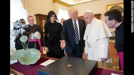 Pope Francis exchanges gifts with President Trump and Melania Trump during an audience at the Apostolic Palace in Vatican City.