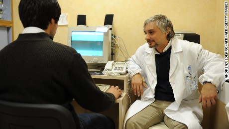 Doctor Federico Tonioni (R), a psychiatrist at the Gemelli clinic of Rome, listens to a patient on November 3, 2009. Tonioni and his team are launching a treatment for the internet addiction syndrome.  AFP PHOTO / ANDREAS SOLARO  TO GO WITH AFP STORY BY Anne-Sophie LEGGE (Photo credit should read ANDREAS SOLARO/AFP/Getty Images)