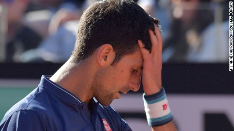TOPSHOT - Novak Djokovic of Serbia reacts during the ATP Tennis Open final against Alexander Zverev of Germany, on May 21, 2017 at the Foro Italico  in Rome.  / AFP PHOTO / Tiziana FABI        (Photo credit should read TIZIANA FABI/AFP/Getty Images)