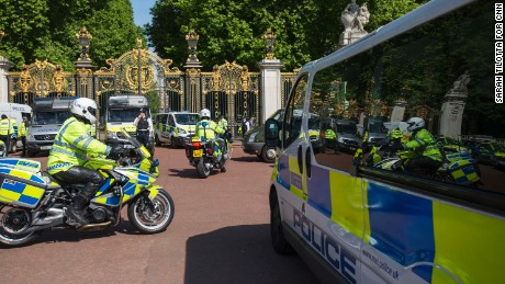 Police safeguard Buckingham Palace in London on Wednesday.
