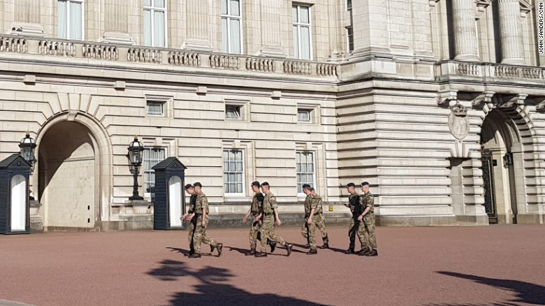 Soldiers march through the grounds of Buckingham Palace in London, two days after an apparent terrorist attack on an Ariana Grande concert in Manchester.
