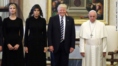 Pope Francis (right) poses with Donald Trump (center), first lady Melania Trump and the daughter of Trump Ivanka Trump (left) at the end of a private audience at the Vatican on May 24, 2017.