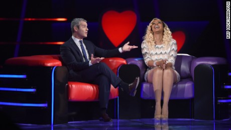 "Host Andy Cohen and contestant Sheena Nicole Williams in the series premiere of ""Love Connection"""