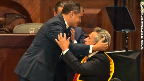 Ecuadorean outgoing President Rafael Correa embraces Ecuadorean new President Lenin Moreno (R) at the National Assembly in Quito on May 24, 2017, during Moreno's inauguration ceremony. / AFP PHOTO / Rodrigo BUENDIA        (Photo credit should read RODRIGO BUENDIA/AFP/Getty Images)