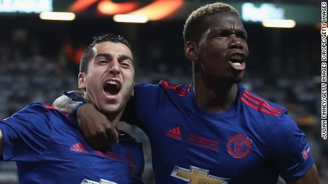 Henrikh Mkhitaryan celebrates scoring his side's second goal with Paul Pogba