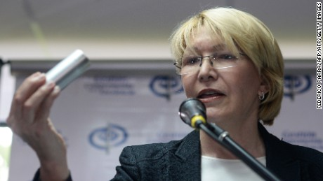Venezuela's Chief Prosecutor Luisa Ortega Diaz shows a tear gas pump during a press conference in Caracas, on May 24, 2017. Venezuela's President Nicolas Maduro formally launched moves to rewrite the constitution on Tuesday, defying opponents who accuse him of clinging to power in a political crisis that has prompted deadly unrest. / AFP PHOTO / FEDERICO PARRA        (Photo credit should read FEDERICO PARRA/AFP/Getty Images)
