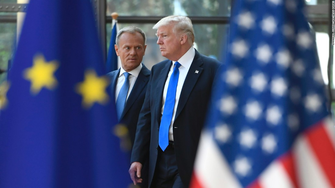 Tusk talks to Trump as he welcomes him in Brussels.